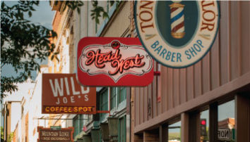 Shot of buisiness signs in downtown Bozeman, photo courtsey Montana OFfice of Tourism